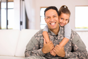 beautiful little daughter and military father at home